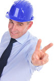 Senior engineer showing the victory sign Royalty Free Stock Photo