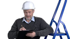 Senior engineer with step ladder and clipboard. stock video