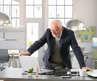 Senior engineer working with computer at office Stock Photos