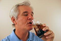 Senior Enjoying a Cold Cola Stock Photos