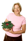 Senior enjoying her gardening Royalty Free Stock Photos