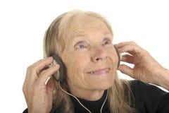 Senior Enjoys music Royalty Free Stock Photo