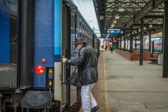 Senior entering train. Senior entering local train that starts its journey in centre of Prague stock photography