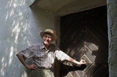 Senior enters the door Stock Photo