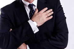 Senior executive, arm on chest Stock Image