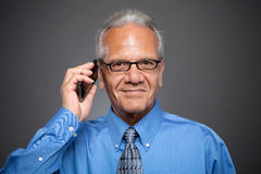 Senior Executive with cell phone Stock Photography