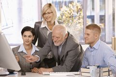 Senior executive discussing work with team Royalty Free Stock Images