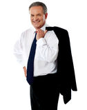 Senior executive holding coat over his shoulders Stock Photos