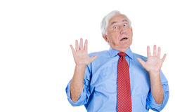 Senior executive man with hands up, surprised, shocked, scared, Royalty Free Stock Photos