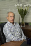 Senior executive in office Stock Photo
