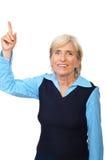 Senior executive  points to copyspace Royalty Free Stock Photo