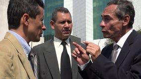 Senior Executive Talking To Employees. Older business men or executives royalty free stock image