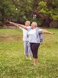 Senior exercise - healthy aged couple resting after sport exercises- together we workout better stock image