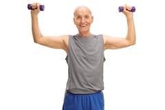 Senior exercising with dumbbells Stock Image
