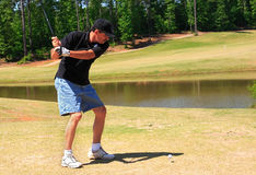 Senior Fairway Golf. Senior male golfer shooting from the fairway Royalty Free Stock Photos