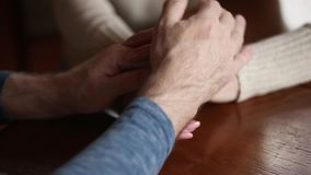 Senior family couple grandparents holding hands expressing support, close up. Senior old family couple grandparents holding hands as love care concept, elderly stock video