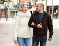 Senior family couple walking at city street Royalty Free Stock Image
