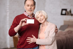 Senior family stading with insuarence card Royalty Free Stock Images