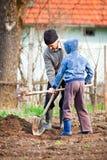 Senior farmer with grandson in the garden Stock Photos
