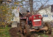 Senior farmer plowing Royalty Free Stock Photo