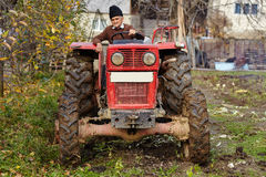 Senior farmer plowing Royalty Free Stock Photo
