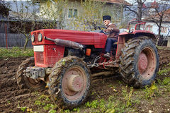 Senior farmer plowing Royalty Free Stock Images