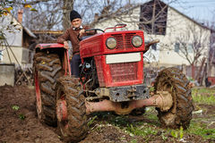 Senior farmer plowing Stock Photography
