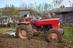 Senior farmer plowing Stock Image