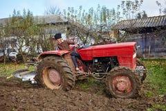 Senior farmer plowing Stock Image