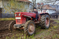 Senior farmer plowing Stock Photo