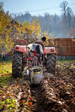 Senior farmer plowing Stock Images