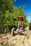 Senior farmer repairing his tractor. Outdoor in the field Stock Images