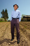 Senior farmer standing outdoor Stock Photo