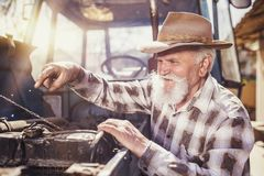 Senior farmer on a tractor Stock Photo
