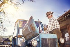 Senior farmer on a tractor Stock Images