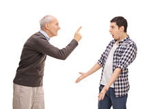 Senior father arguing with his adult son Royalty Free Stock Photography