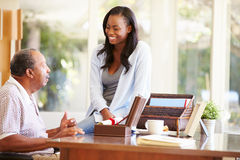 Senior Father Discussing Document With Adult Daughter Royalty Free Stock Photography
