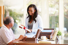 Senior Father Discussing Document With Adult Daughter Royalty Free Stock Images
