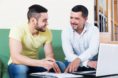 Senior father helping adult son Stock Photography