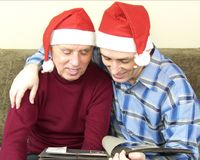 Senior father and son sharing memories Royalty Free Stock Images