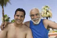 Senior Father and Son sitting outdoors. Front view portrait Royalty Free Stock Photo