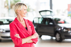 Senior female car dealer principal Royalty Free Stock Photo