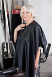 Senior Female Customer Standing At Salon Stock Photography