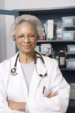 Senior Female Doctor With Arms Crossed In Clinic royalty free stock images