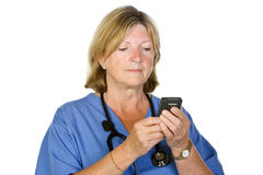 Senior Female Doctor Checking Pager Stock Images