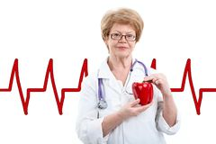 Senior female doctor holding red sweet papper in hands with heartbeat line on background, isolated in white. Senior female doctor holding red sweet papper in royalty free stock photos