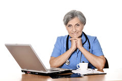 Senior female doctor with laptop Stock Photo