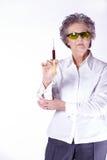 Senior female doctor with syringe Stock Images