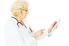 Senior Female Doctor Using Digital Tablet Royalty Free Stock Photos