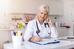 Doctor writing a prescription royalty free stock photos